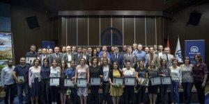 AA'da 15'inci yılını dolduran personellere sertifika
