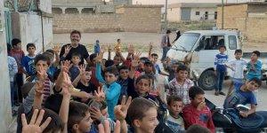 Adana İHH Suriye'nin Asumbul köyünde iftar verdi..