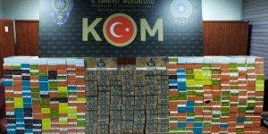 Adana'da iş yerindeki gizli bölmeden kaçak elektronik sigaralar çıktı